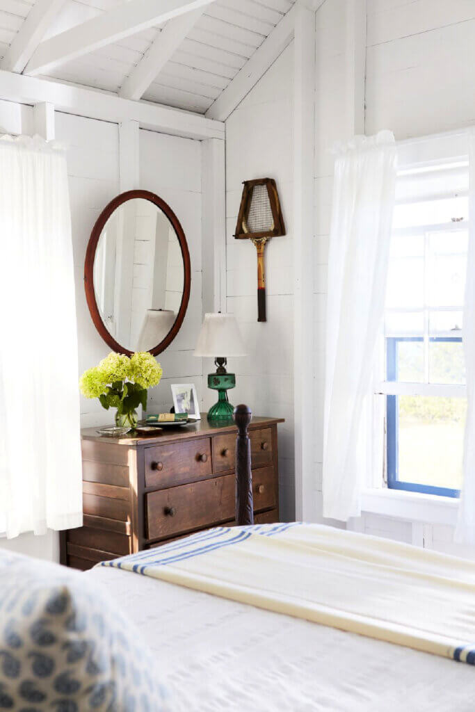 This Martha's Vineyard beach cottage is simply with casual furnishings like this vintage dresser and bed.