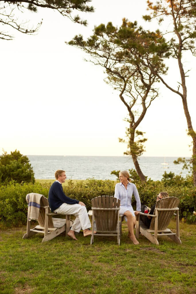 At the Martha's Vineyard beach cottage, the family enjoys evening cocktails.