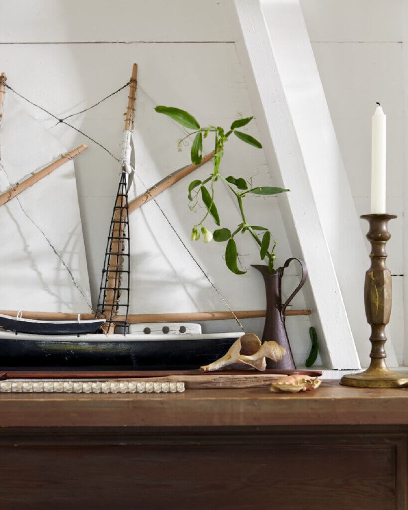 The sailboat weather vane from Phoebe's grandfather's Martha's Vineyard home now graces the mantel.