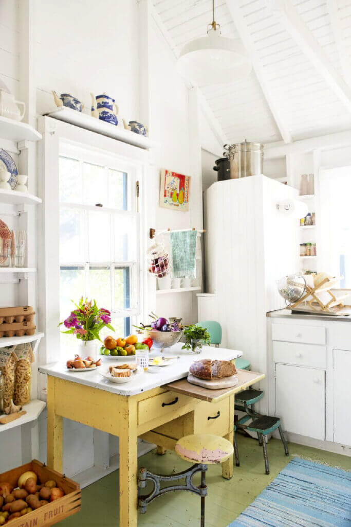 A simple kitchen with old-fashioned furnishings grace this Martha's Vineyard beach cottage.