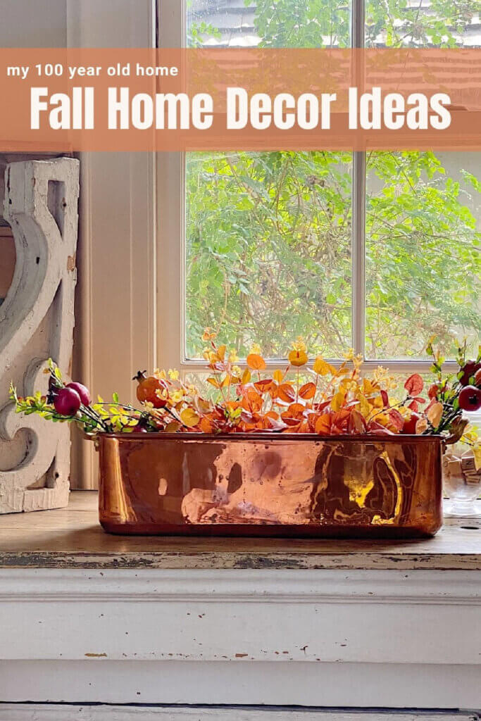 Home decor idea with a brass pot and fall leaves inside for mentions