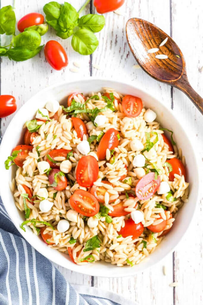 this caprese orzo salad is the first recipe in this post about salads made long before a meal