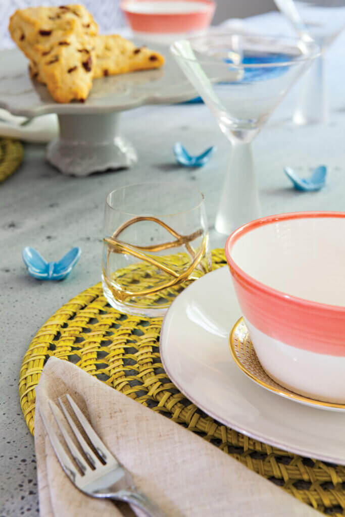 Little blue ceramic butterflies add whimsy to the table