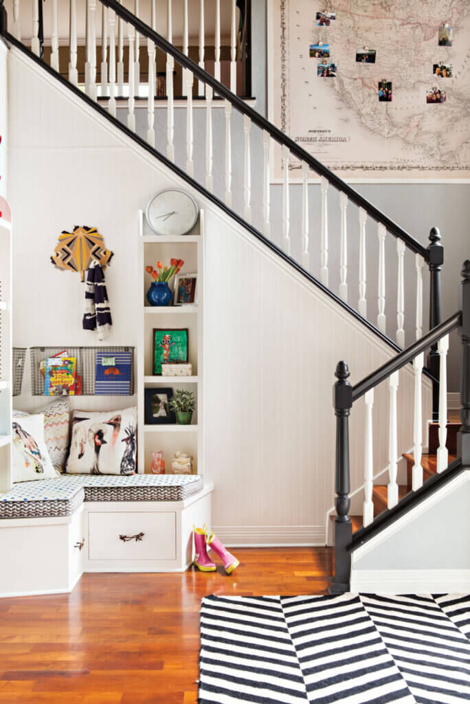 The stairs in this newly renovated Austin home now has a black banister