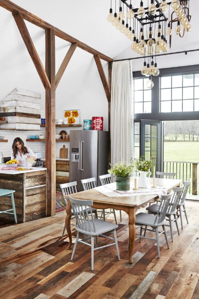 The dining room is open and has views of the acreage in this hayloft that became their home.