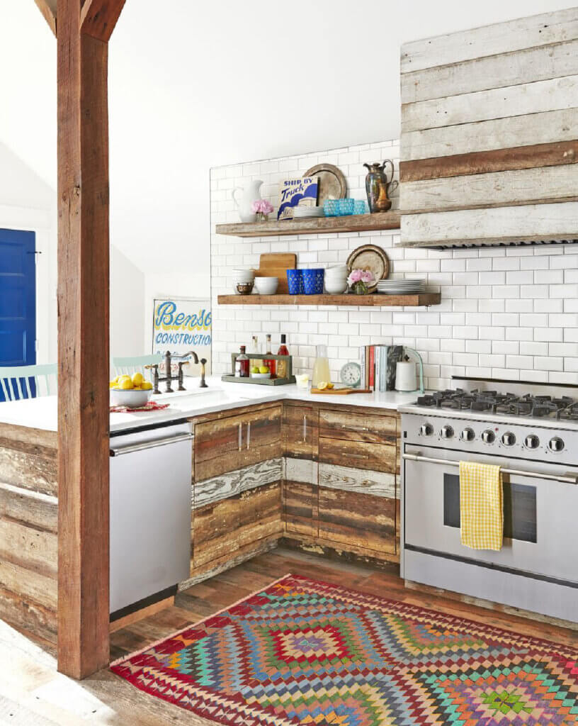 Reclaimed wood from other buildings on the property were used for the cabinets in the kitchen of the Tennessee hayloft turned into a home.