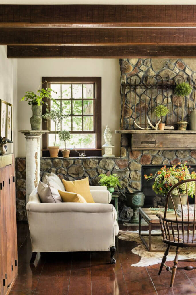 One wall of the living room is covered with stone.
