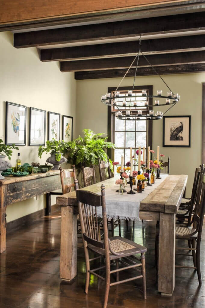 The dining room in this new build saltbox farmhouse has a distressed table and chairs.