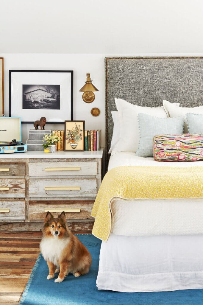 The cozy bedroom of the rustic home that was once a barn's hayloft.