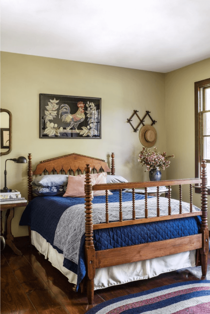 The master bed in the saltbox farmhouse is flanked by two antique sidetables.