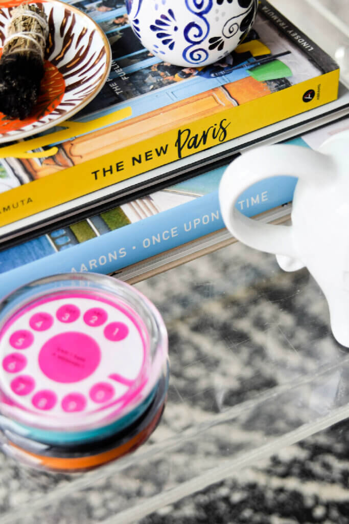 Books and such decorate a table in her stylish Washington DC apartment