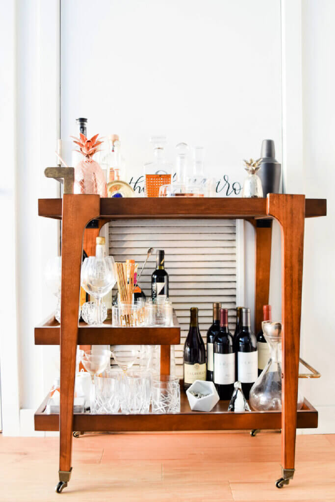 A wood bar cart is perfect with drinks to share with friends.