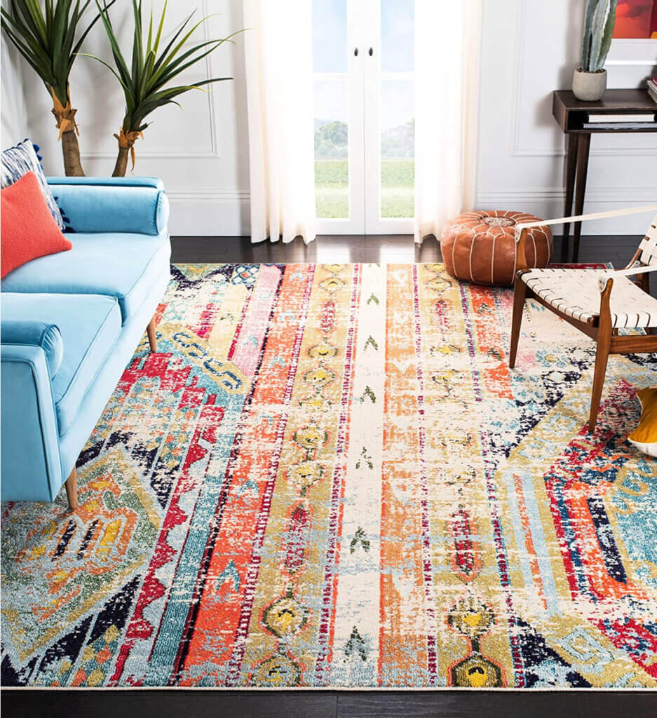 Decide what theme you want to go with. This colorful rug goes well with the blue couch