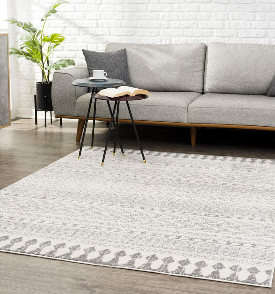 When choosing an area rug, think of the furniture in that room in color and size