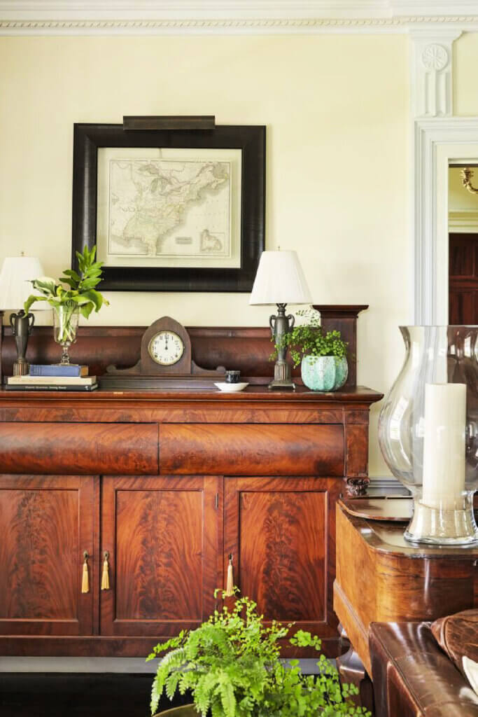 An antique buffet sits in the vintage and modern New York farmhouse