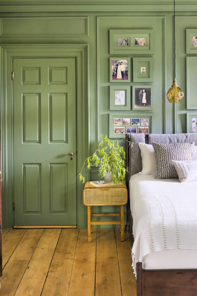 A soft green shade is the color of the other bedroom. Even the door is green.