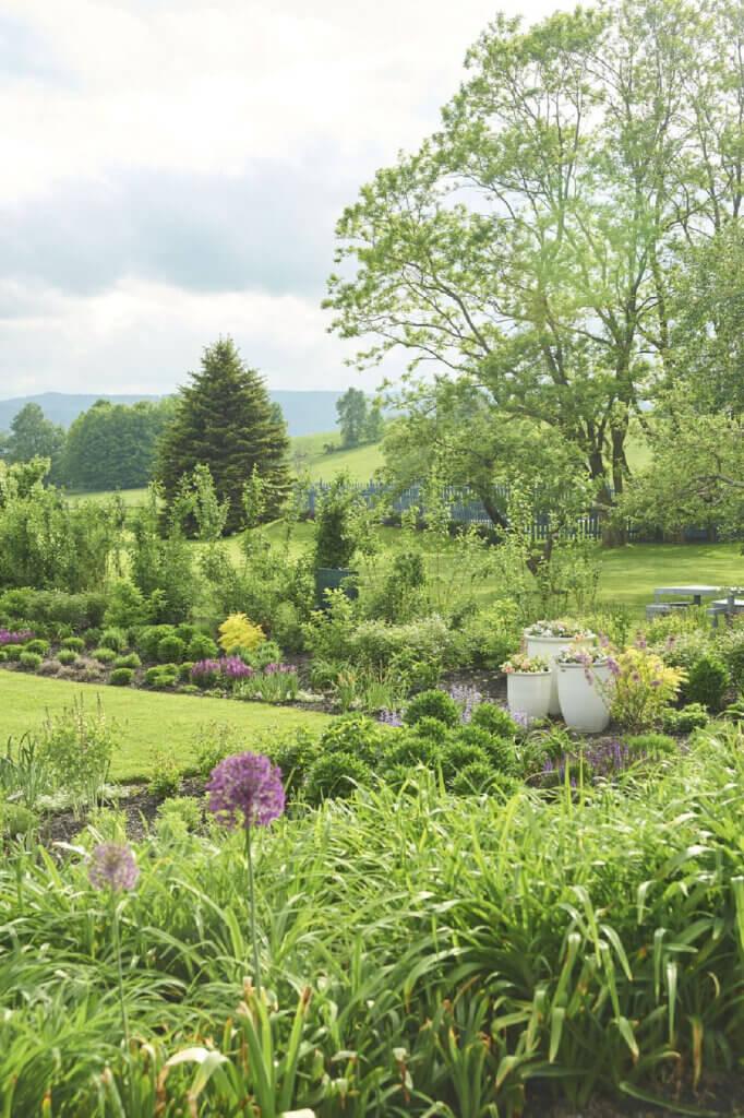 The vintage and modern New York farmhouse has a moon garden on their land
