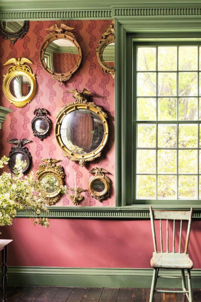 A vintage mirror collection share space on one wall.