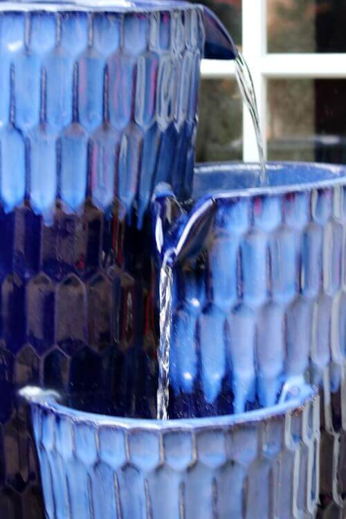 Blue outdoor fountain I ordered from Wayfair on my patio